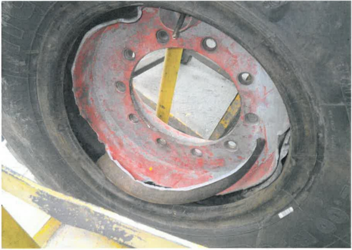 [image] close-up view of tyre, showing rim damage