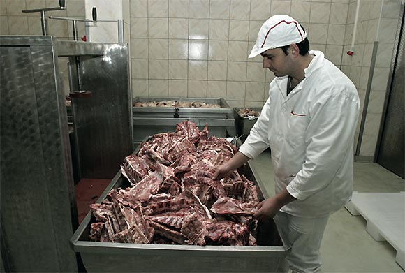 image meat worker preparing meat for processing